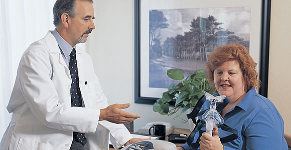 Sleep Disorder Treatment Physician Discussing CPAP Face Mask With Patient