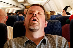 Tired Airline Passenger Sleeping during Flight